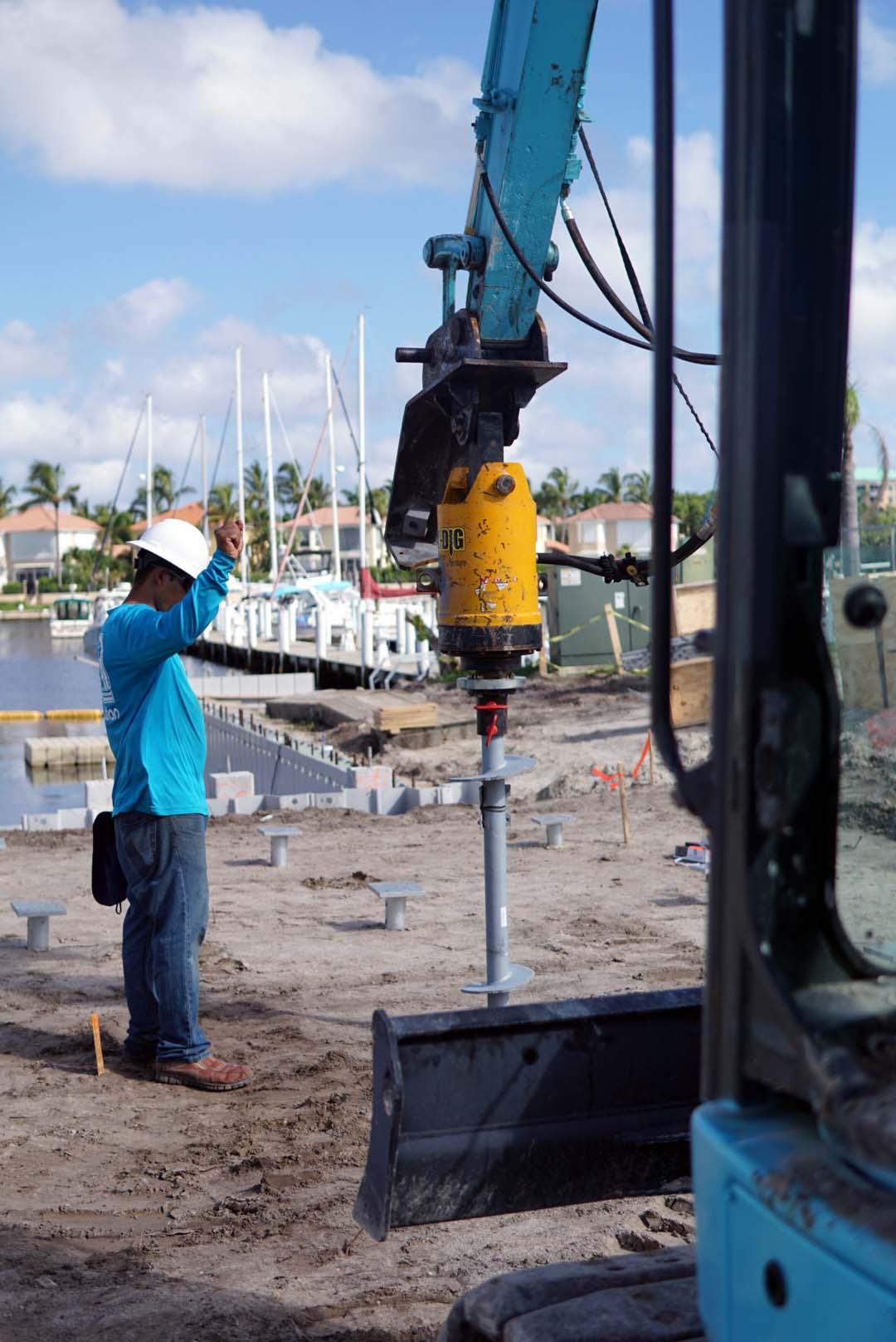 https://coastalfoundationsolutions.com/wp-content/uploads/2019/03/helical-installation.jpg