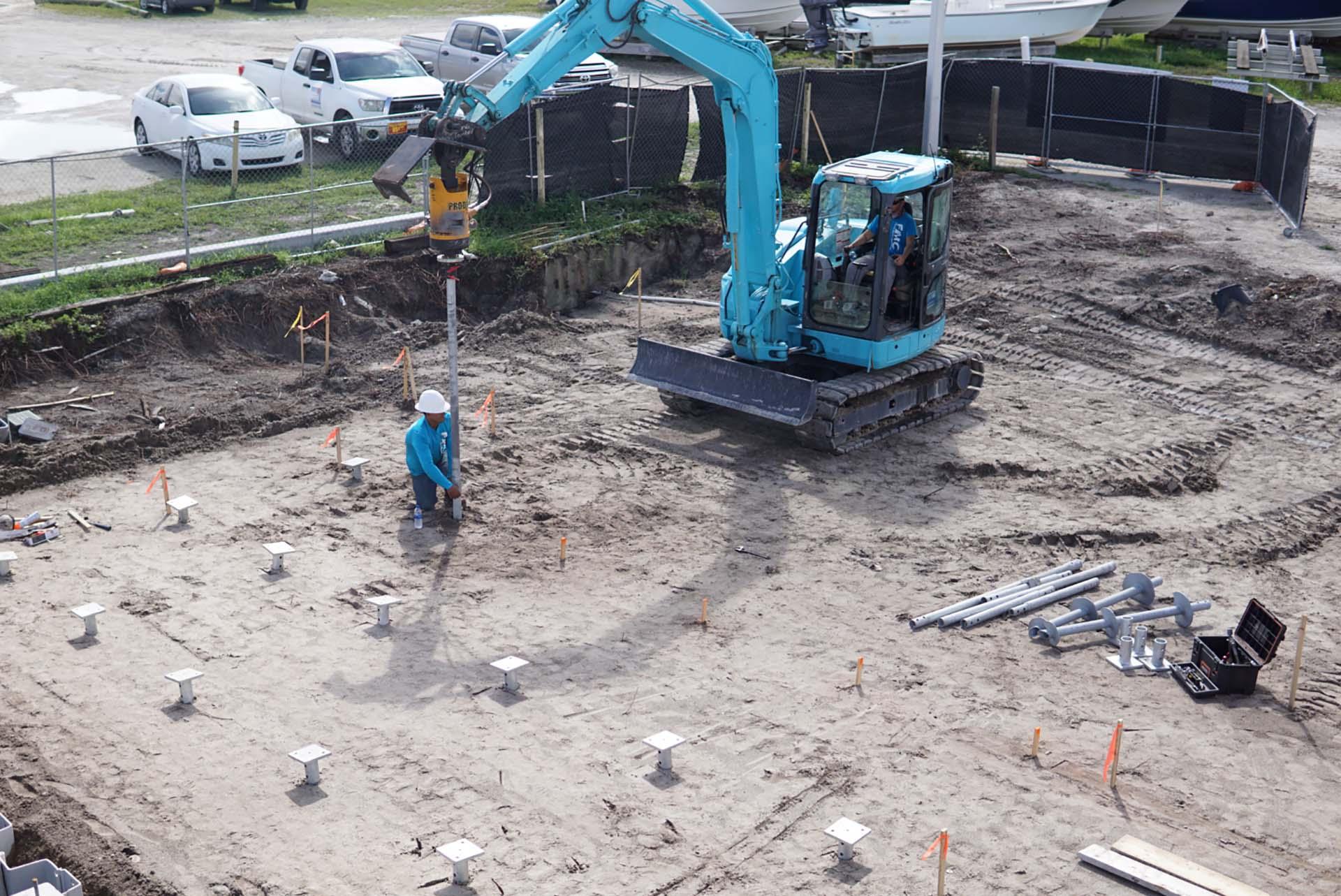 https://coastalfoundationsolutions.com/wp-content/uploads/2019/03/helical-pile-foundation-installation-swfl.jpg